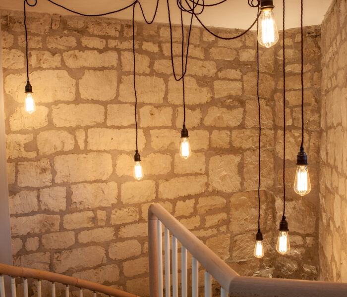 Bespoke Pendant light to illuminate beautiful stone and spiral staircase.